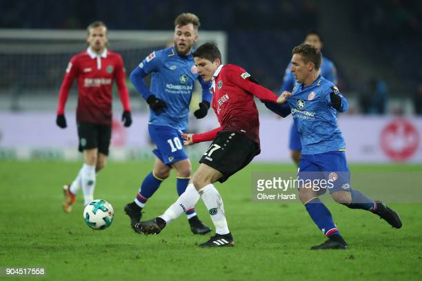 Pirmin Schwegler of Hannover and Pablo De Blasis of Mainz compete for the ball during the Bundesliga match between Hannover 96 and 1 FSV Mainz 05 at...