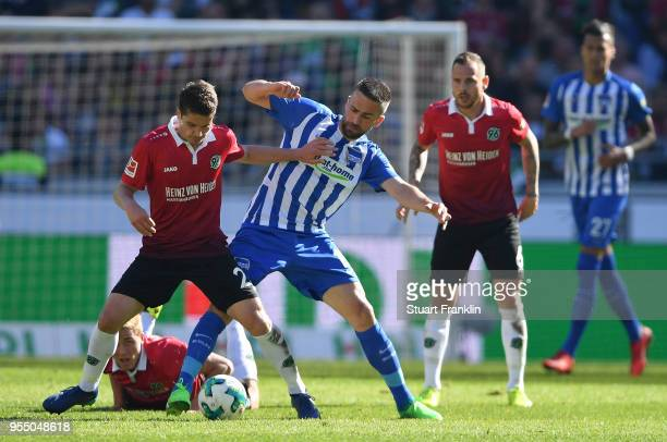 Pirmin Schwegler of Hannover is challenged by Vedad Ibisevic of Berlin during the Bundesliga match between Hannover 96 and Hertha BSC at HDIArena on...