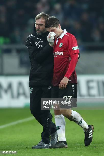 Pirmin Schwegler of Hannover walks off the pitch after picking up an injury during the Bundesliga match between Hannover 96 and 1 FSV Mainz 05 at...