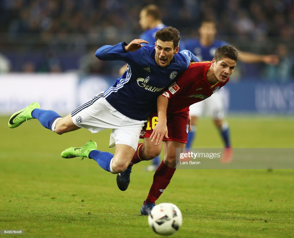 Pirmin Schwegler of Hoffenheim is challenged by Leon Goretzka of Schalke during the Bundesliga match between FC Schalke 04 and TSG 1899 Hoffenheim at Veltins-Arena on February 26, 2017 in Gelsenkirchen, Germany.