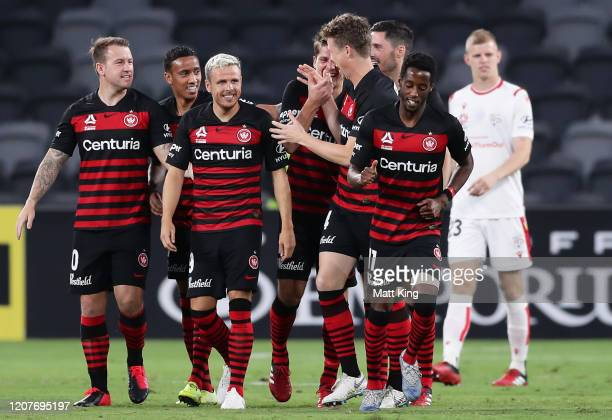 Pirmin Schwegler of the Wanderers celebrates with team mates after scoring a goal during the round 20 A-League match between the Western Sydney...