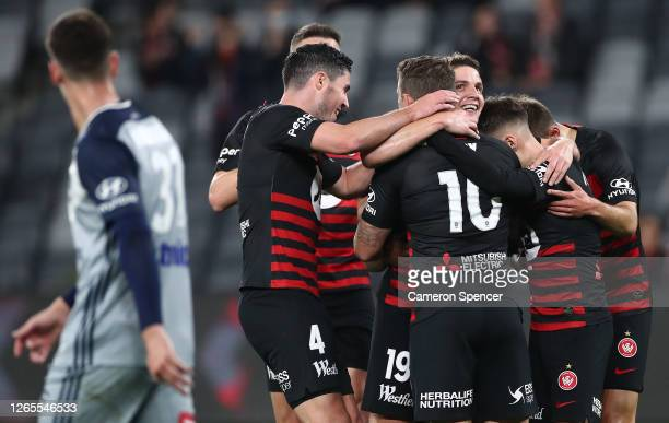 Pirmin Schwegler of the Wanderers celebrates with team mates after scoring a goal during the round 27 A-League match between the Western Sydney...