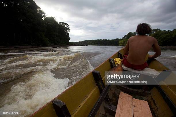 Pirogue in the rapids of the Approuague River, French Guiana, South America