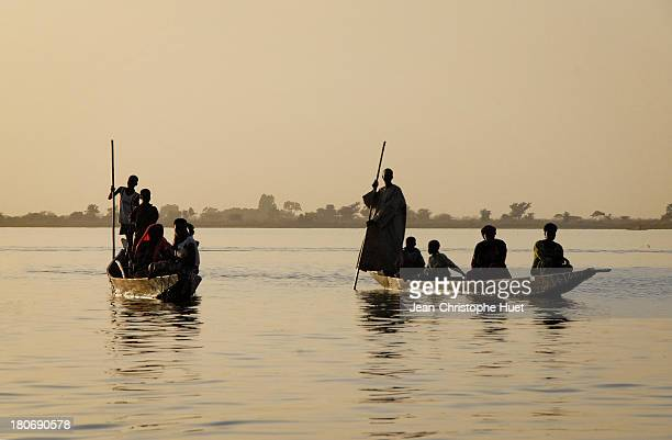 CONTENT] Pirogues on the Niger river at sunset Segou