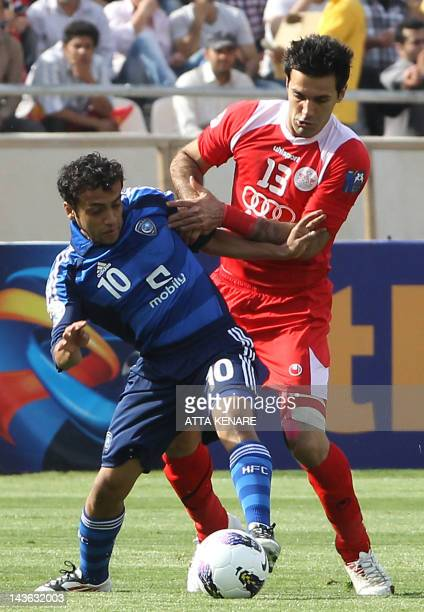 Piroozi Athletic's Iranian defender Sheys Rezaei Khonakdar challenges AlHilal's Saudi midfielder Mohammed alShalhub during their AFC Champions League...