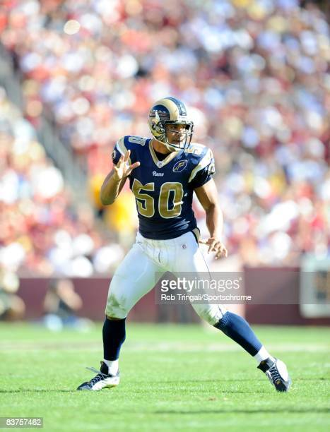 Pisa Tinoisamoa of the St. Louis Rams defends against of the Washington Redskins at FedEx Field on October 12, 2008 in Landover, Maryland. The Rams...