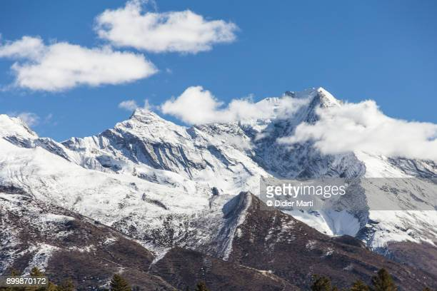 pisang peak in the himalayas in nepal - didier marti stock photos and pictures