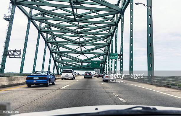 piscataqua river bridge expressway traffic speeding toward maine usa - us state border stock photos and pictures