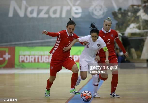 Pisko of Portugal with Nikitina of Russia and Rodkina of Russia in action during the FUTSAL International match between Portugal and Russia at...
