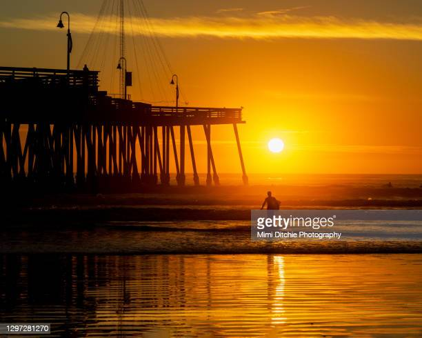 pismo beach surfer at sunset - pismo beach stock pictures, royalty-free photos & images