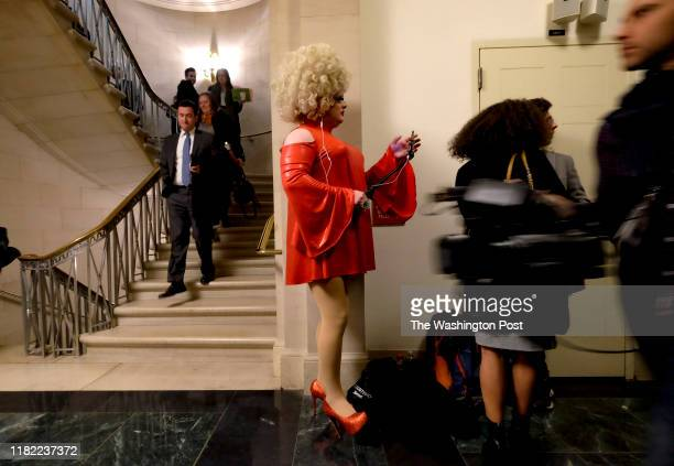 Pissi Myles a reporter for Happs waits outside the room where Ambassador William Taylor and Deputy Assistant Secretary George Kent provide testimony...