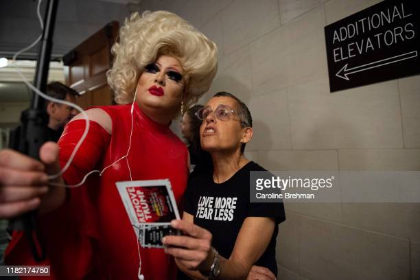 Pissi Myles left and a protester record a video outside the hearing room where the House Intelligence Committee hearing on the impeachment inquiry of...
