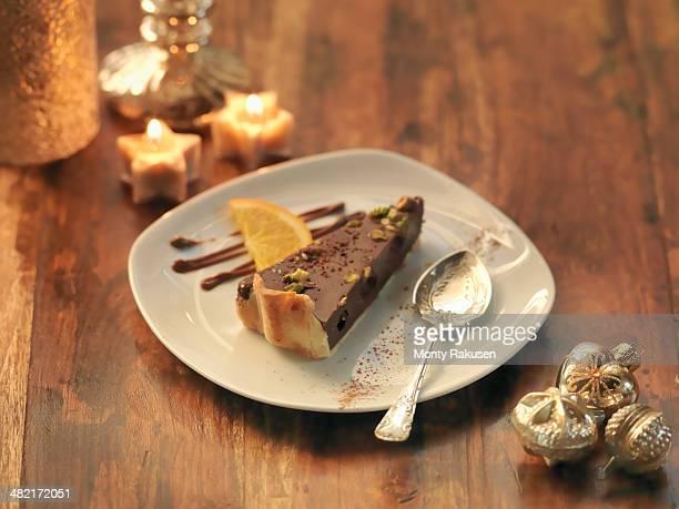 pistachio and chocolate torte amongst festive decorations - オトレイ ストックフォトと画像