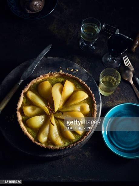 pistachio frangipane poached pear tart - bastille day stock pictures, royalty-free photos & images