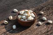 pistachio nut wooden bowl rusty wood