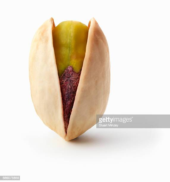 Pistachio nut upright in shell on white background