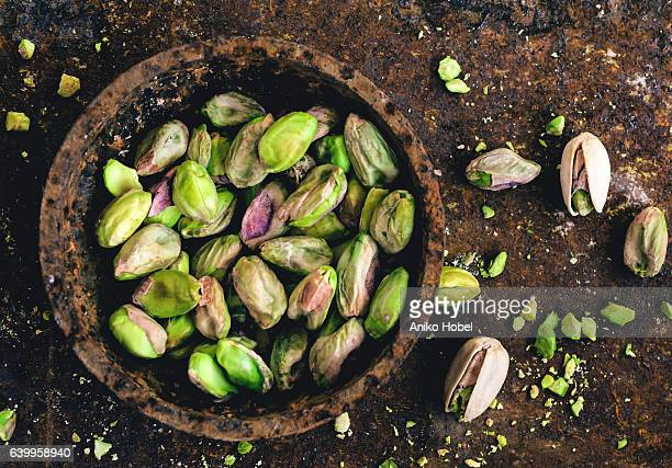 pistachio nuts - fat nutrient stock pictures, royalty-free photos & images