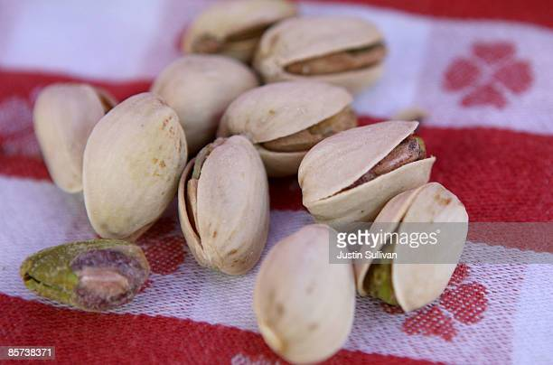 Pistachios sit on a table during the Ferry Plaza farmers' market March 31 2009 in San Francisco California The US Food and Drug Administration is...