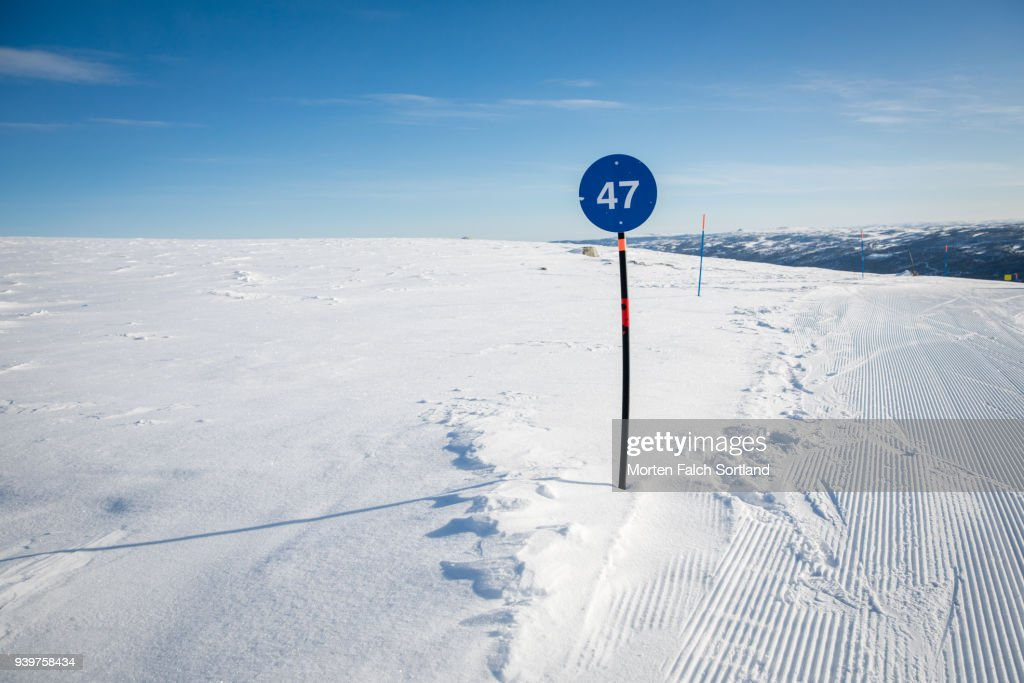 A Piste Marker on a Ski Slope in Southern Norway, Wintertime : Stock Photo