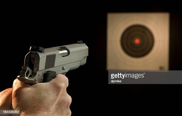 Pistol aiming at target