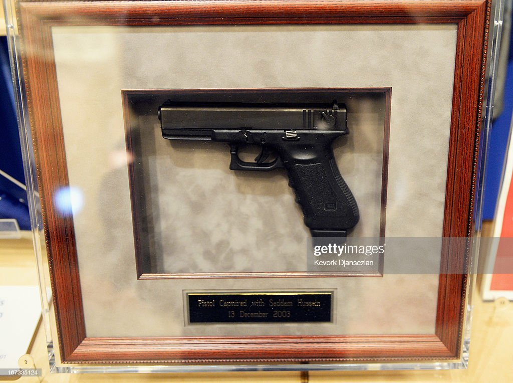A pistol captured with Saddam Hussein on December, 13, 2003, is displayed during a tour of the George W. Bush Presidential Center on the campus of Southern Methodist University on April 24, 2013 in Dallas, Texas. Dedication of the George W. Bush Presidential Library is to take place on April 25 with all five living U.S. Presidents in attendance and an expected 8,000 invitation-only guests.