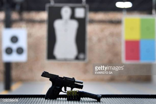 Pistol is displayed at a shooting club in Brasilia, on April 13, 2021. - A judge of the Supreme Federal Court of Brazil suspended on late April 12,...