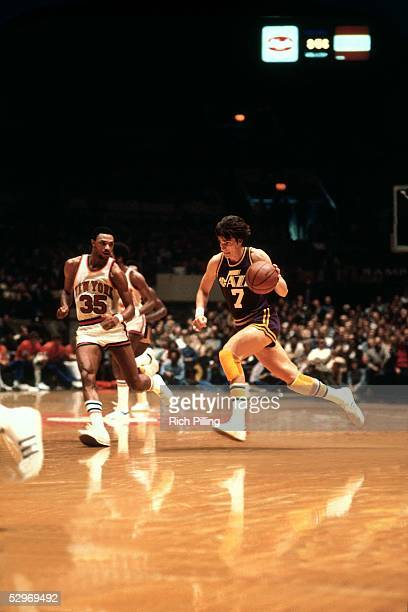 'Pistol' Pete Maravich of the New Orleans Jazz drives against the New York Knicks during an NBA Game at Madison Square Garden circa 1979 in New York...