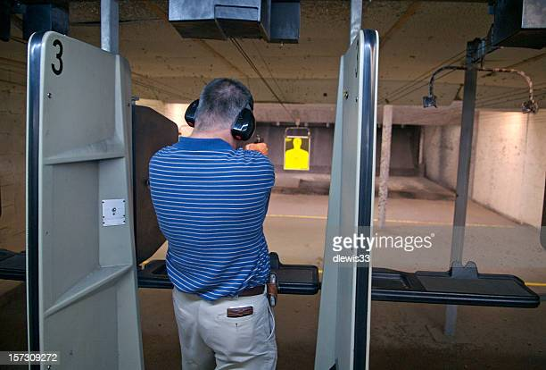 pistol practice at indoor range - target shooting stock pictures, royalty-free photos & images