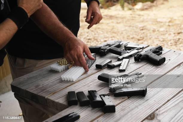 """Pistols and other weapons are displayed at a shooting range during the """"Rod of Iron Freedom Festival"""" on on October 12, 2019 in Greeley,..."""