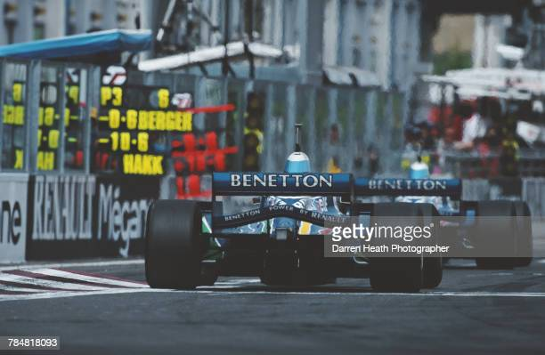 Pit board messages from the Benetton team are held out as Jean Alesi of France drives the Mild Seven Benetton Renault Benetton B196 Renault V10 ahead...