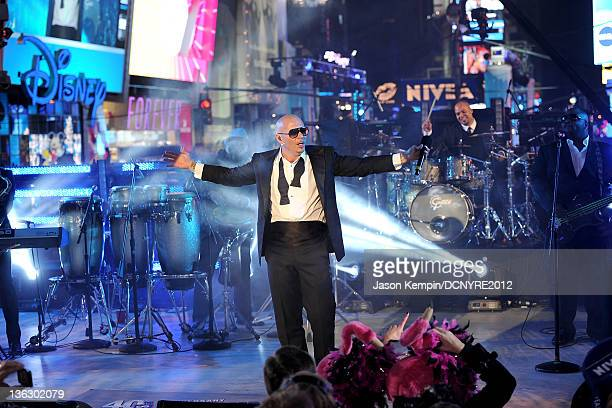 Pit Bull performs onstage during Dick Clark's New Year's Rockin' Eve with Ryan Seacrest 2012 at Times Square on December 31, 2011 in New York City.