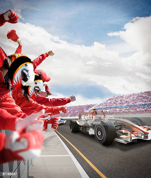 pit crew cheers for winning driver - motorsport stock pictures, royalty-free photos & images