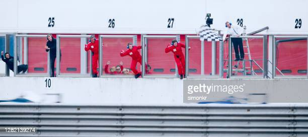pit crew members at pit stop - motorsport stock pictures, royalty-free photos & images