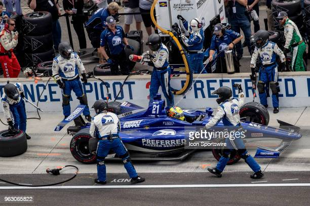 Pit crew members preform a pitstop for Spencer Pigot driver of the Ed Carpenter Racing Chevrolet during the running of the 102nd Indianapolis 500...