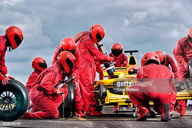 Pit Crew Servicing Formula One Racecar