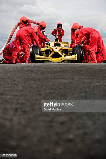 Pit Crew Servicing Racecar