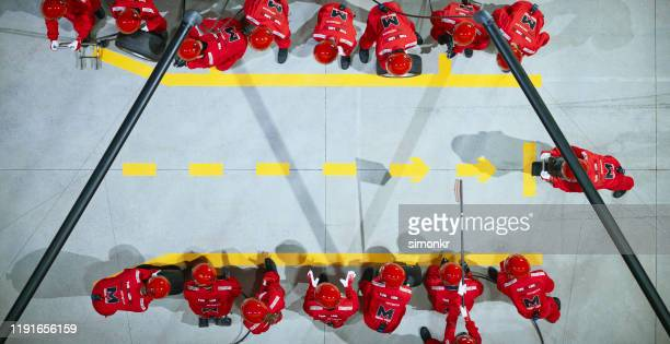 pit crew waiting at pit stop - pit stop stock pictures, royalty-free photos & images