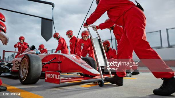 pit crew working at pit stop - pit stop stock pictures, royalty-free photos & images