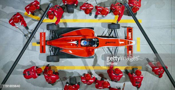 pit crew working at pit stop - sports team stock pictures, royalty-free photos & images