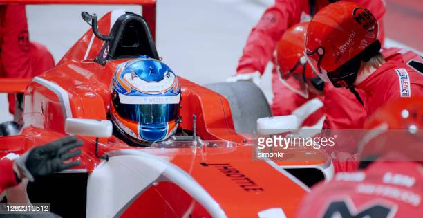 pit crew working at pit stop - racing driver stock pictures, royalty-free photos & images