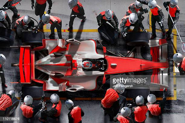 F1 pit crew working on F1 car.