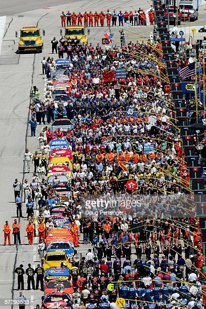 Pit crews line up during the National Anthem before the start of the NASCAR Nextel Cup Series Samsung/RadioShack 500 at the Texas Motor Speedway on...