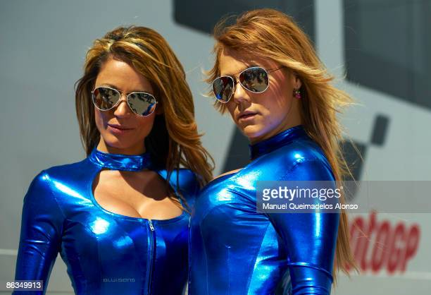 Pit girls pose for photographers during the Moto GP qualifying session of the Spanish Grand Prix at the Jerez racetrack on May 2 2009 in Jerez de la...