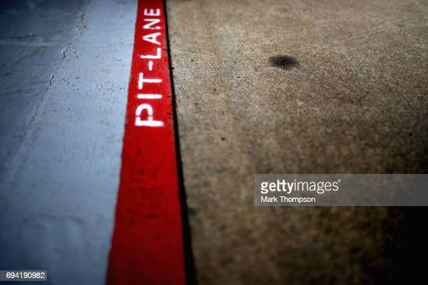Image was created using a variable planed lens Pit lane marking outside the Red Bull Racing garage during practice for the Canadian Formula One Grand...