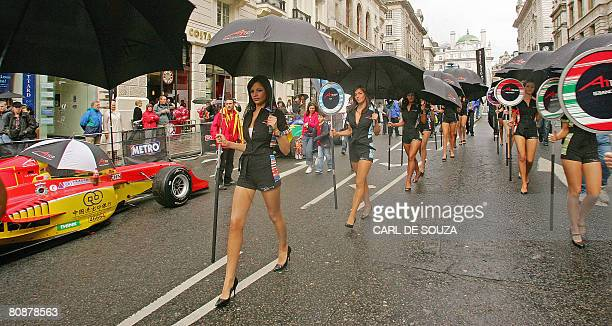 Pit Lane models walk around an A1 Grand Prix motor racing show in London on April 27 2008 22 A1 Grand Prix cars were lined up on Regent street London...