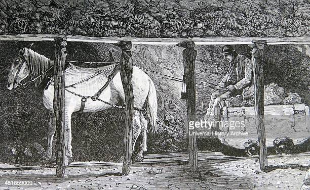 Pit pony pulling a coal wagon on rails underground in a Welsh coal mine Engraving Paris 1885
