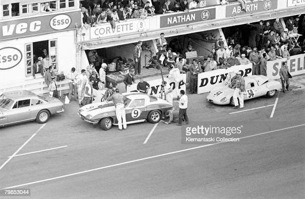 Pit stop action for the Dana Chevroletentered Corvette driven by Bob Bondurant and Dick Gullstrand during the The 24 Hours of Le Mans race June 1011...