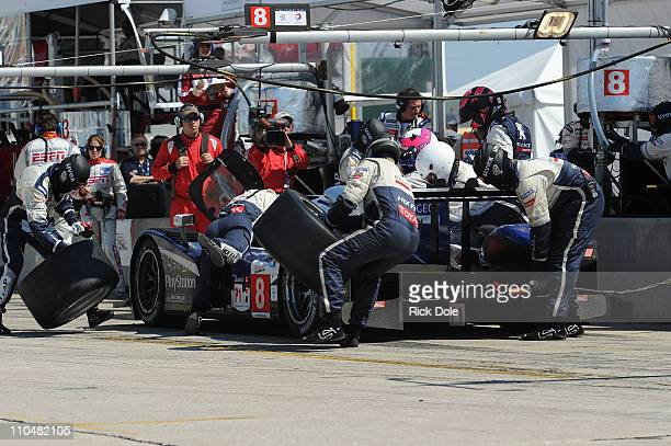 Pit stop for the Peugeot Sport Total Peugeot 908 of Pedro Lamy of Portugal, Stephane Sarazin and Franck Montagny both of France, during the...