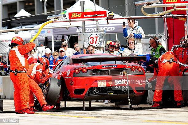 A pit stop for the Risi Competizione Ferrari 430 GT driven by Mika Salo Pierre Kaffer and Jamie Melo during the 57th Annual Mobil1 12 Hours of...