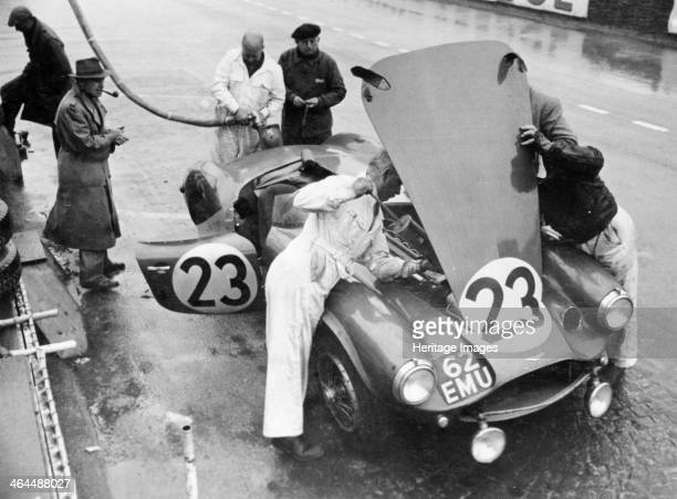 Pit stop Le Mans 24 Hours France 1955 The Aston Martin DB3S of Peter Collins and Paul Frere being worked on and refuelled The car finished the race...
